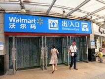 Walmart in China. The entrance to a Walmart in China with people going in and out royalty free stock photo