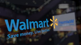 Walmart logo on the glass against blurred business center. Editorial 3D rendering Stock Photo