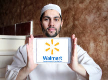 Walmart logo. Logo of the international chain of convenience stores walmart on samsung tablet holded by arab muslim man Royalty Free Stock Photography