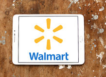 Walmart logo. Logo of the international chain of convenience stores walmart on samsung tablet on wooden background Royalty Free Stock Images