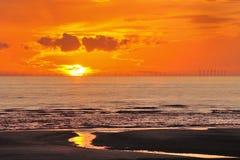 Walney windfarm, solnedgång Arkivbilder