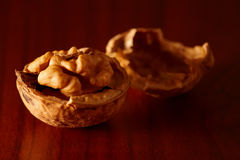 Walnut. And nutshell on wooden table. Nice side lighting Royalty Free Stock Photography