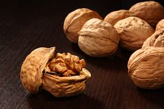 Walnut. The walnuts on dark background Royalty Free Stock Images