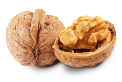 Walnut. Whole and chopped walnuts isolated on a white background Royalty Free Stock Photography