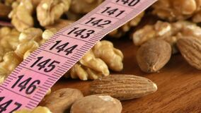 Walnut Almond and Measurement Macro View. Video stock video footage