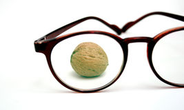 Walnut behind the Glasses Stock Photos