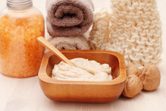 Walnut body scrub. With some walnuts - beauty treatment Royalty Free Stock Images