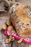 Walnut Bread. (fresh baked) on dark vintage wooden background Royalty Free Stock Images