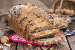 Walnut Bread. (fresh baked) on dark vintage wooden background Royalty Free Stock Photos