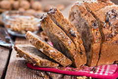 Walnut Bread (fresh baked). Portion of fresh baked Walnut Bread on dark wooden background Stock Photos
