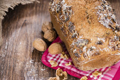 Walnut Bread (fresh baked). Portion of fresh baked Walnut Bread on dark wooden background Stock Photography