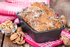 Walnut Bread (fresh baked). Portion of fresh baked Walnut Bread on dark wooden background Stock Images