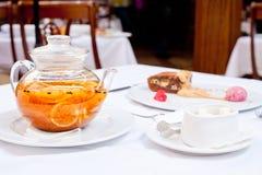 Walnut Brownies under Ice Cream with Sea-Buckthorn and Orange Tea Stock Photos