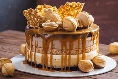 Walnut cake with glaze. Layered mousse walnut cake with caramel glaze stock photos
