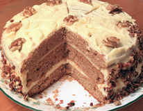 Walnut Cake. Home Made Multiple-Layered Walnut cream and butter Cake in Plate Stock Photography