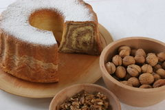 Walnut cake with piece cut off nuts Royalty Free Stock Photos