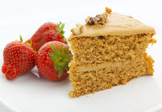 Walnut cake with strawberries Stock Images