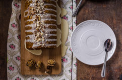 Walnut cake topped with white chocolate Royalty Free Stock Image