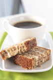 Walnut cake. Two slices of walnut cake and a cup of coffee Stock Photos