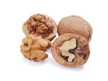 Walnut and a cracked walnut isolated on white Stock Photos