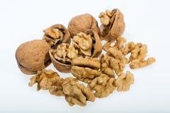 Walnut and a cracked walnut Royalty Free Stock Photography