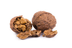 walnut and a cracked walnut isolated on the white background Royalty Free Stock Photo