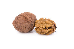 walnut and a cracked walnut isolated on the white background Royalty Free Stock Photos
