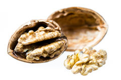 Walnut and a cracked walnut isolated on the white background Royalty Free Stock Images