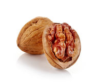Walnut and cracked walnut  isolated on white backround Stock Photos