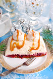 Walnut cream cake with meringue and caramel sauce for christmas Stock Photo