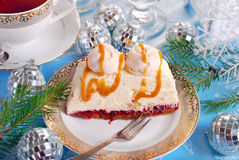 Walnut cream cake with meringue and caramel sauce for christmas Stock Photography