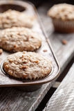 Walnut crumb sweet potato muffins on barn wood table Royalty Free Stock Photography