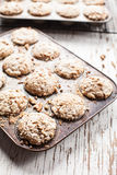 Walnut crumb sweet potato muffins. In an old tin on old weathered white wood Royalty Free Stock Photography
