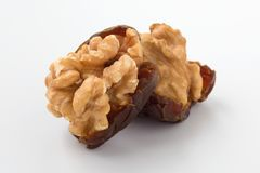 Walnut with date fruit. Walnuts and dried date fruit on white background, closeup royalty free stock image