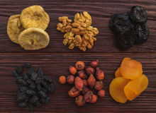 Walnut, figs, dried apricots, prunes, raisins and wild rose on a Stock Photos