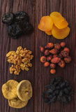 Walnut, figs, dried apricots, prunes, raisins and wild rose on a Royalty Free Stock Images