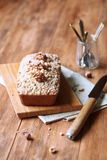 Walnut Financier - traditional French cake. With Crumble Topping, on wooden table stock images