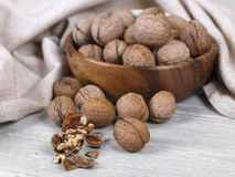 Walnut. Fresh walnuts, wooden cup with the nuts, healthy food Royalty Free Stock Photography