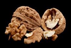 Walnut fruit on black Royalty Free Stock Photography