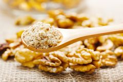 Walnut greound, nutmeat in background Royalty Free Stock Photography