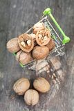 Walnut half in the trolley for food and also a few nuts nearby,. Walnut half in the trolley for food and also a few nuts nearby stock photography
