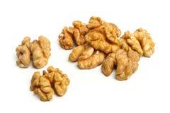 Walnut halves on white. Walnut halves isolated on white royalty free stock photo