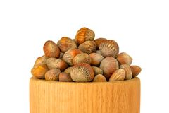 Walnut hazelnut isolate on a white background. Nuts hazel of a T. Urkish wooden bowl. The concept of a healthy dietary diet packed with vitamins vegetarianism stock image