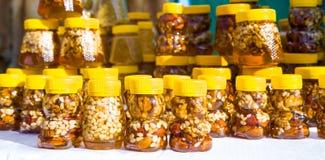 Walnut with honey Royalty Free Stock Photos