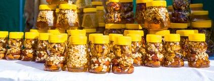 Walnut with honey Stock Image