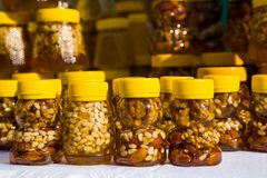 Walnut with honey Stock Photos