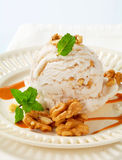 Walnut ice cream with caramel sauce Royalty Free Stock Image