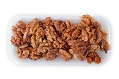 Walnut kernel halfs in a container on white background Royalty Free Stock Image