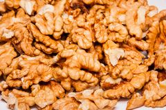 Walnut kernel, halves. Walnut kernel halves in a pile. walnut seeds. Natural ingredient used in bakery. Isolated macro food photo close up from above on white Royalty Free Stock Image