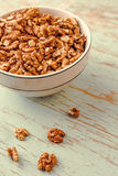 Walnut Kernels in Bowl on Rustic Wooden Background Stock Photography